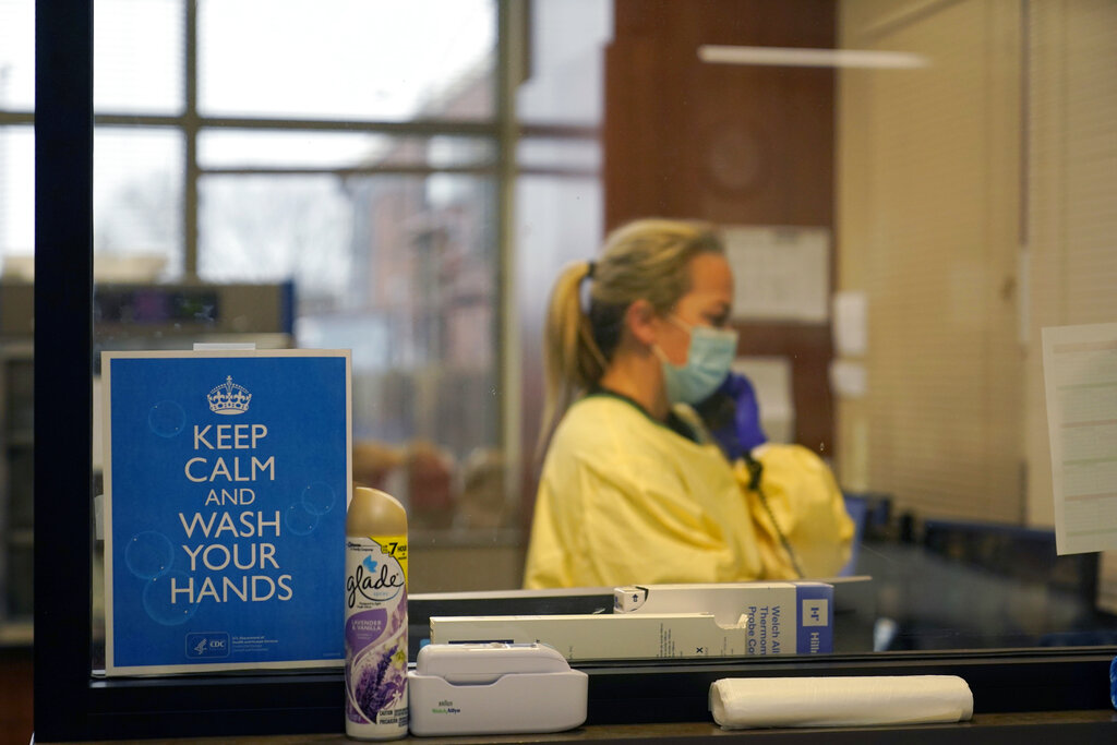In this Nov. 24, 2020, file photo, registered nurse Chrissie Burkhiser works in the emergency room at Scotland County Hospital in Memphis, Mo. (AP Photo/Jeff Roberson, File)