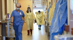 Nurses and medical staff make their way through the seventh floor COVID-19 unit at East Alabama Medical Center Thursday, Dec. 10, 2020, in Opelika, Ala. COVID-19 patients occupy most of the beds in ICU in addition to the non-critical patients on the seventh floor. (AP Photo/Julie Bennett)