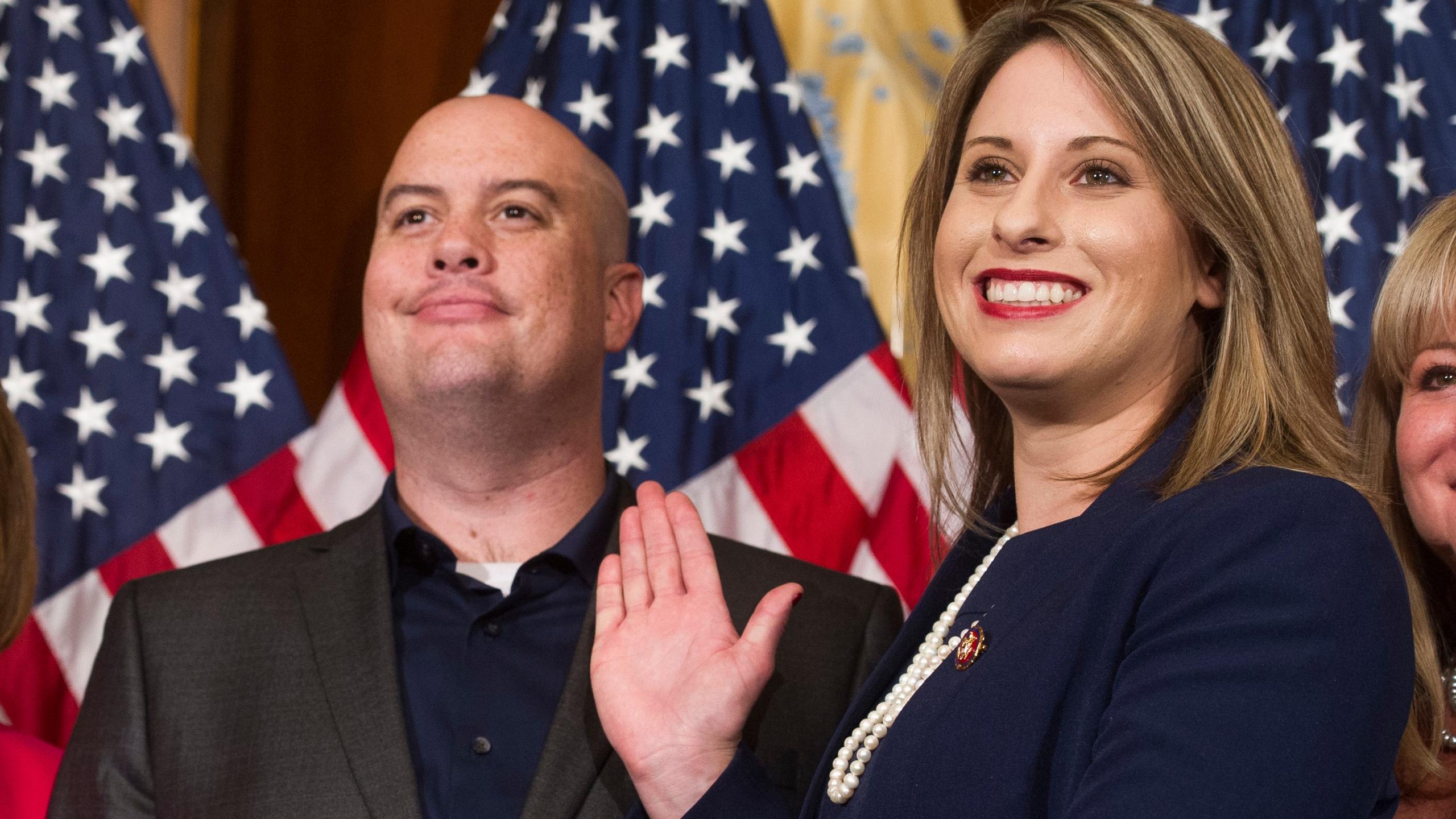 In this Jan. 3, 2019, file photo, Rep. Katie Hill, D-Calif., and Hill's then-husband, Kenneth Heslep, pose during a ceremonial swearing in on Capitol Hill in Washington during the opening session of the 116th Congress. (AP Photo/Cliff Owen, File)
