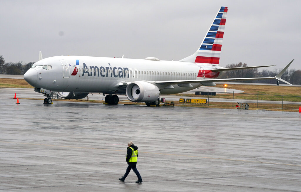 In this Dec. 2, 2020 file photo, an American Airlines Boeing 737 Max jet plane is parked at a maintenance facility in Tulsa, Okla. (AP Photo/LM Otero, File)
