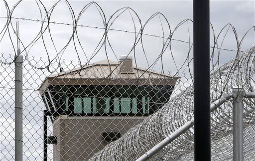 This June 25, 2013 file photo shows a guard tower over the fence surrounding the new California Correctional Health Care Facility in Stockton. (AP Photo/Rich Pedroncelli,File)
