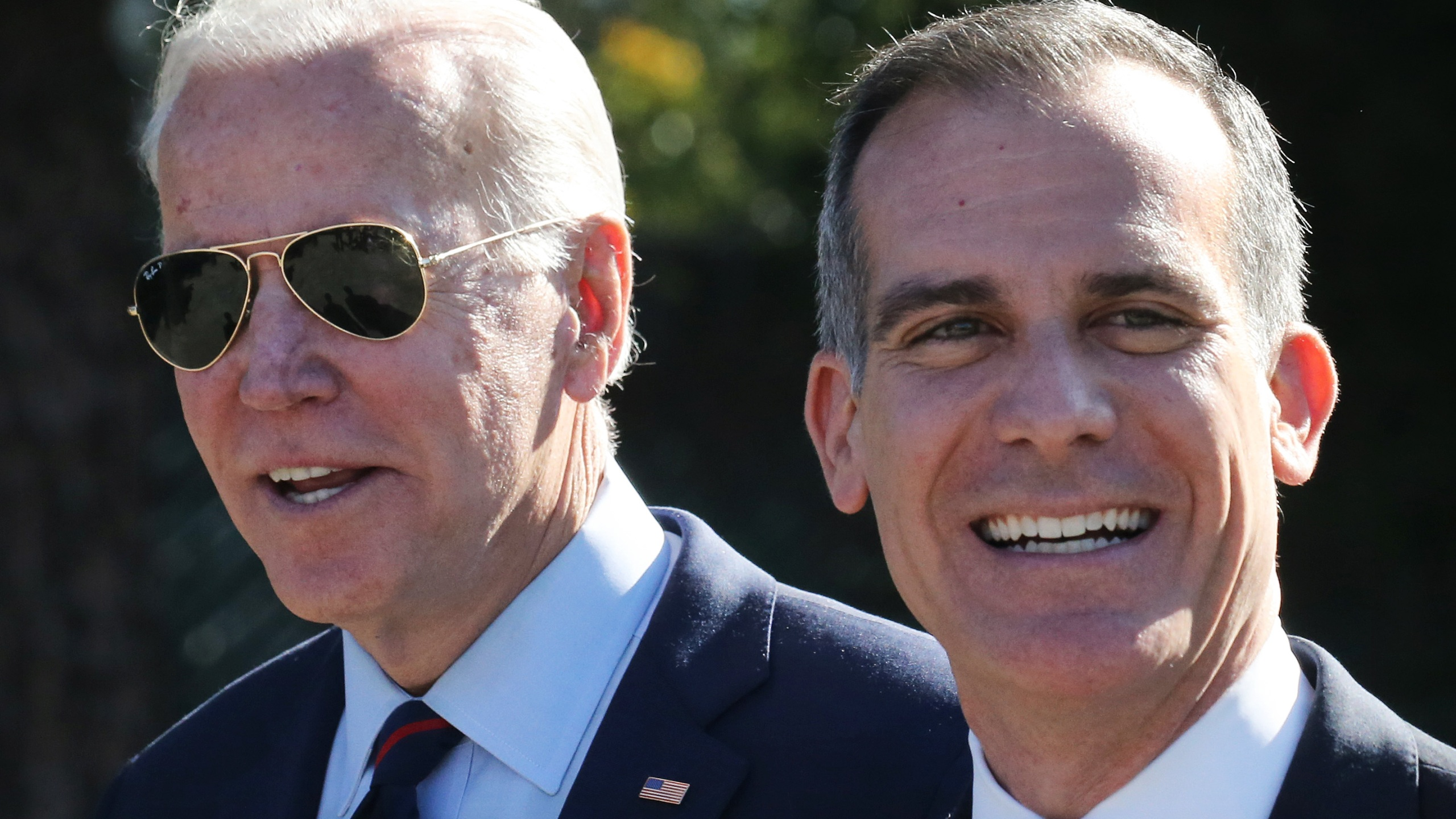 Then-Democratic presidential candidate and former U.S. Vice President Joe Biden (L) walks with Los Angeles Mayor Eric Garcetti at a campaign event at United Firefighters of Los Angeles City on Jan. 10, 2020. (Mario Tama/Getty Images)