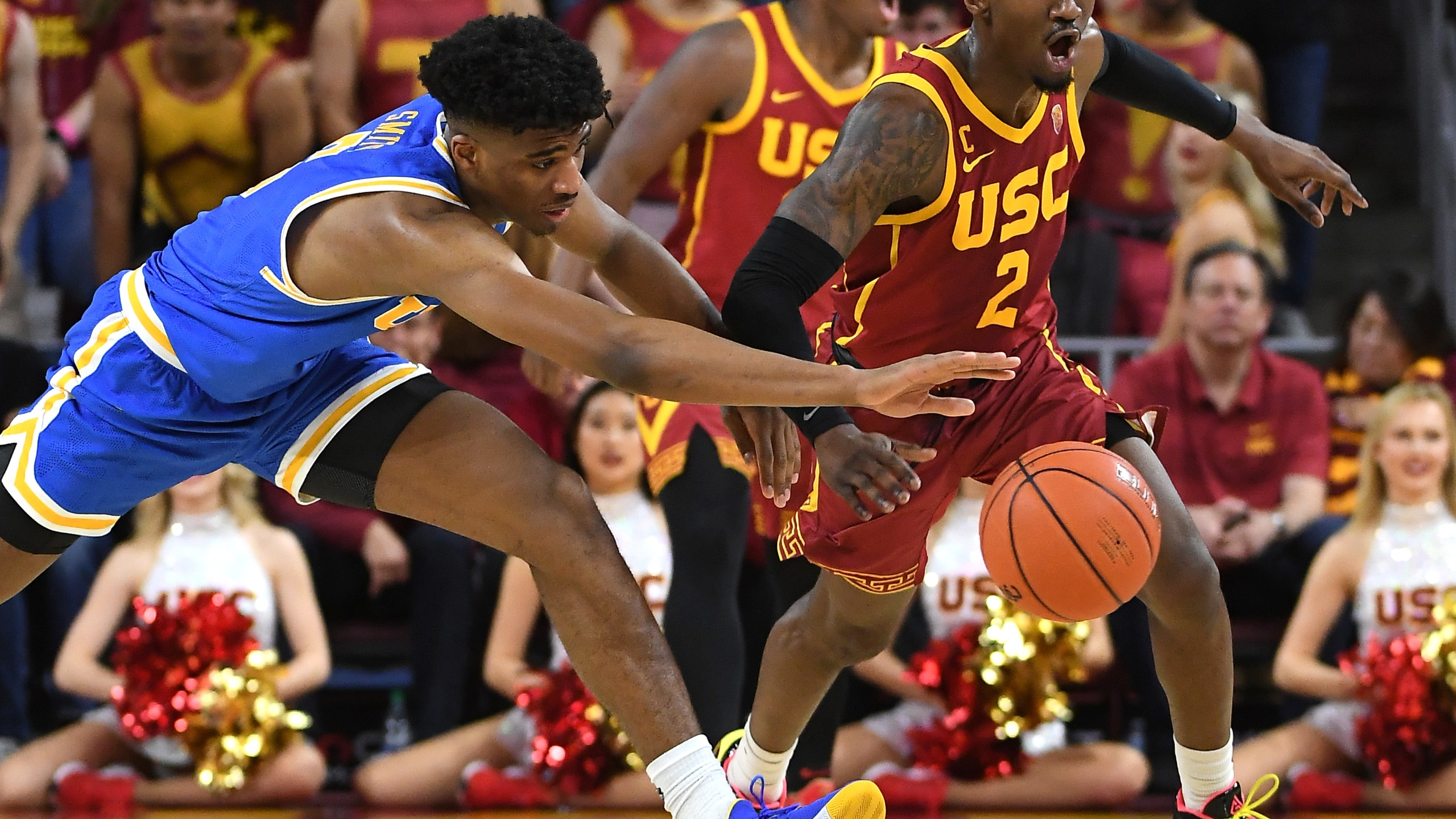 Chris Smith #5 of the UCLA Bruins and Jonah Mathews #2 of the USC Trojans battle for a loose ball in the second half of the game at Galen Center on March 7, 2020 in Los Angeles, California. (Jayne Kamin-Oncea/Getty Images)
