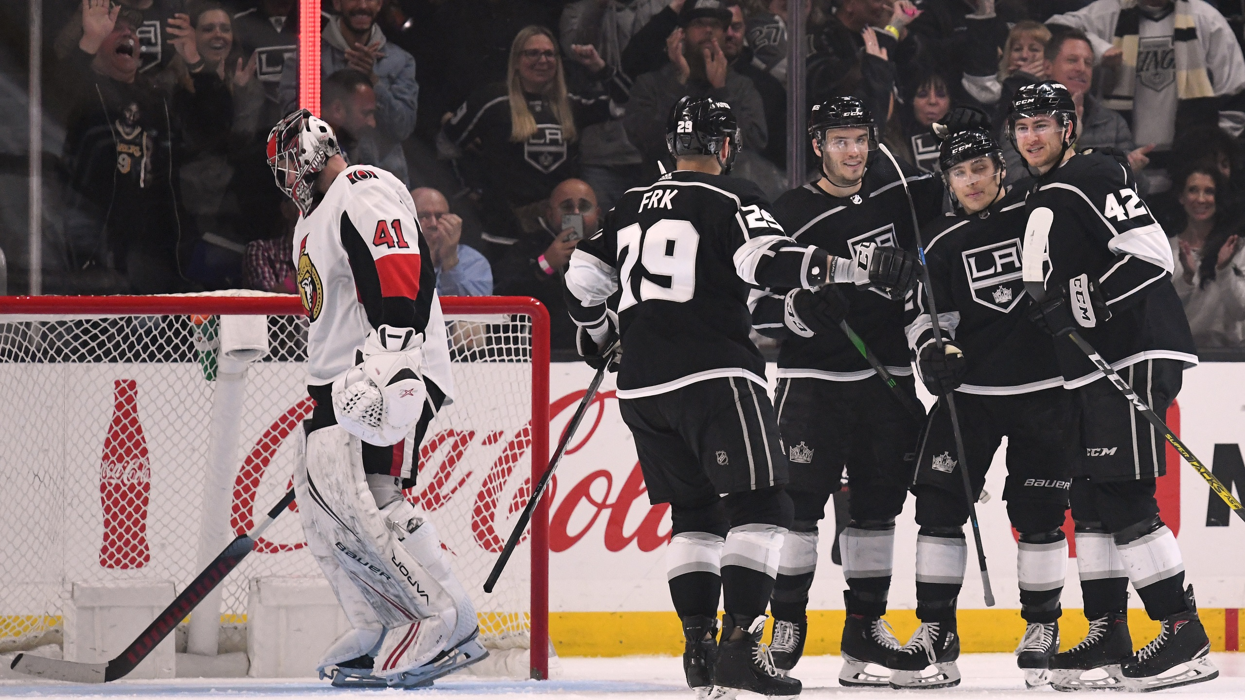 Gabriel Vilardi #42 of the Los Angeles Kings celebrates his goal with Trevor Moore #12, Matt Roy #3 and Martin Frk #29 against Ottawa Senators at Staples Center on March 11, 2020. (Harry How/Getty Images)