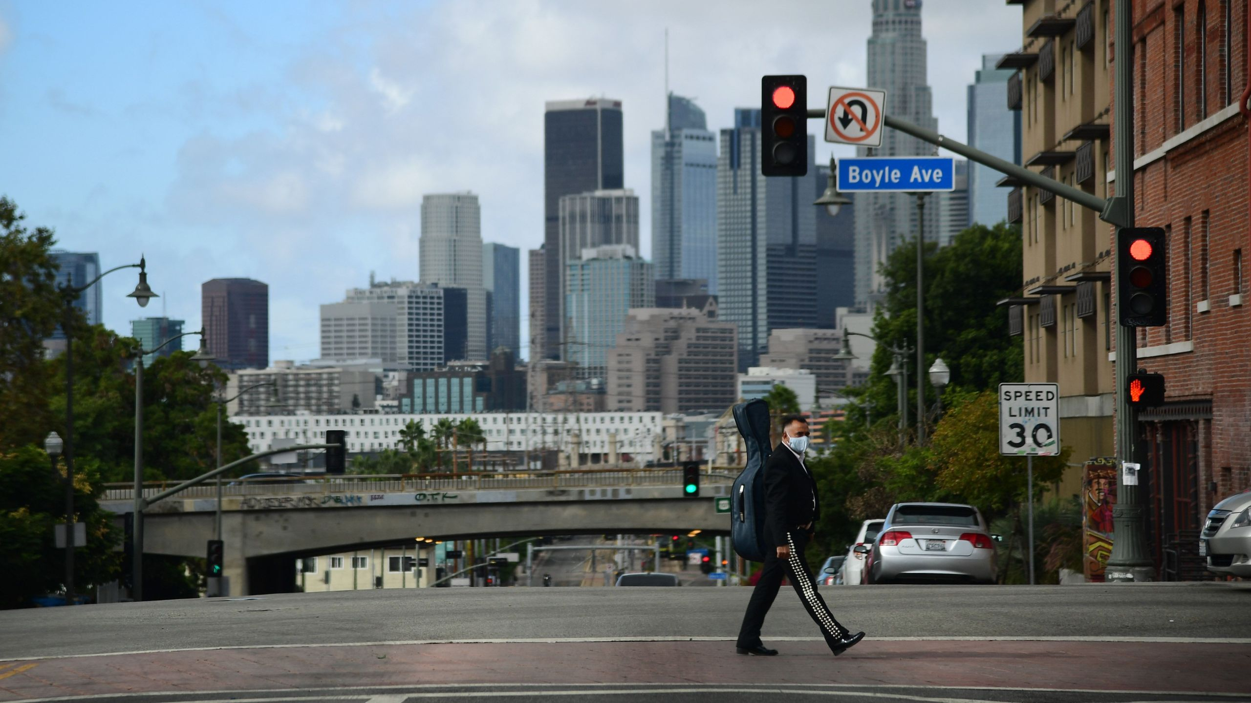 A musician walks towards Mariachi Plaza in Boyle Heights on Nov. 7, 2020. (Robyn Beck / AFP via Getty Images)
