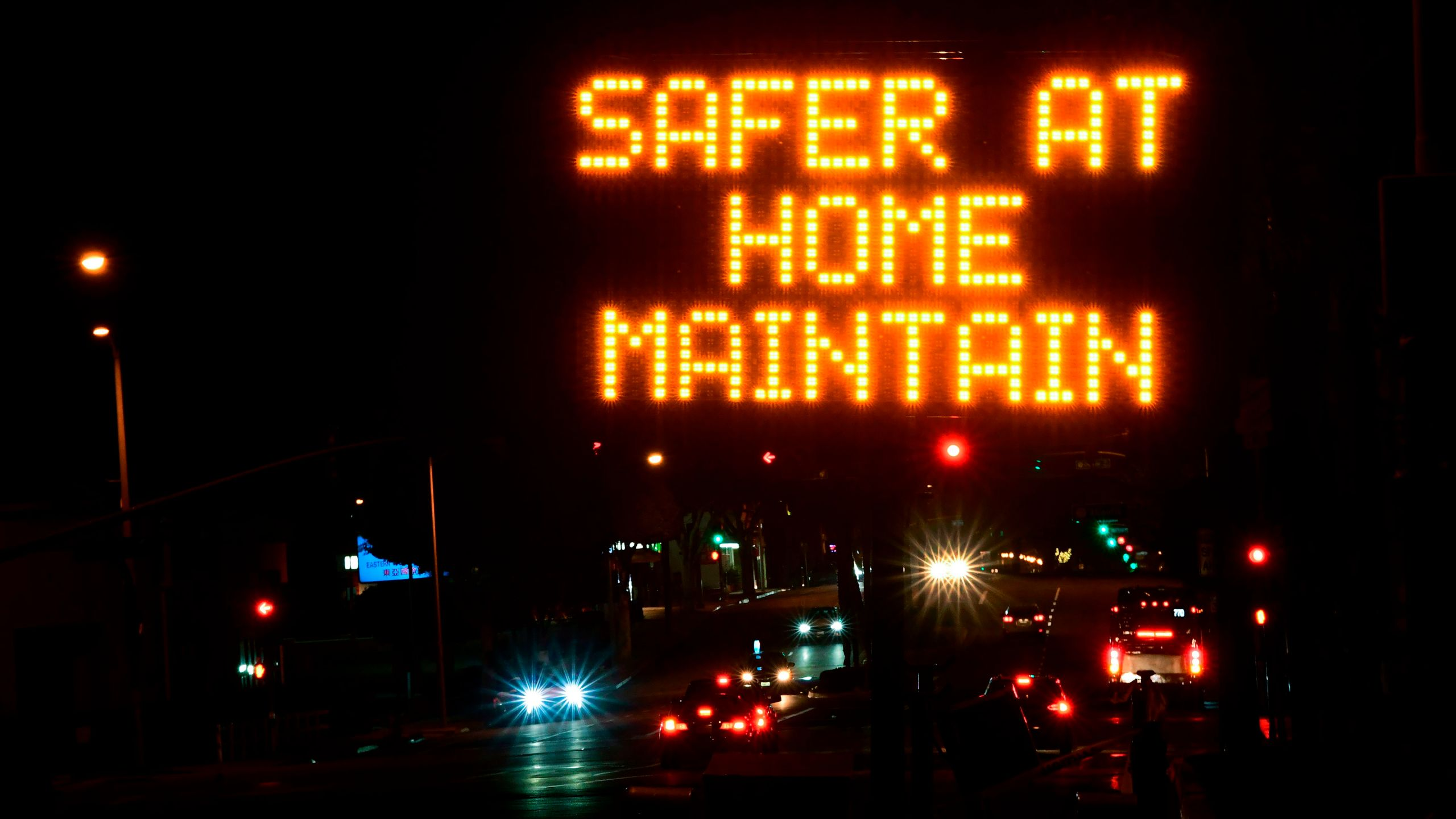 A sign reminds motorists of the Los Angeles County stay-at-home regulation in place for the next three weeks on Dec. 1, 2020. (FREDERIC J. BROWN/AFP via Getty Images)