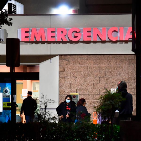 People wait outside the Emergency room of the Garfield Medical Center in Monterey Park, California on Dec. 1, 2020. (FREDERIC J. BROWN/AFP via Getty Images)