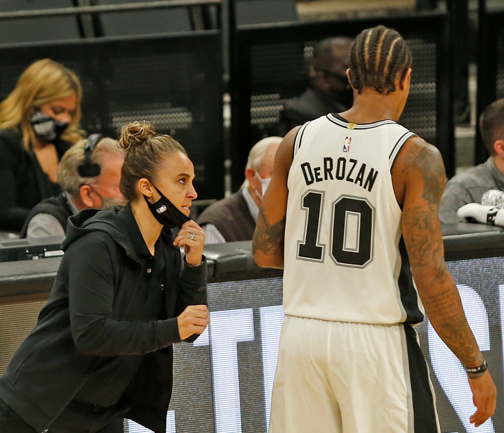 DeMar DeRozan #10 of the San Antonio Spurs receives instruction from assistant coach Becky Hammon, who was filling for an ejected Gregg Popvich during second half action at the AT&T Center in San Antonio, Texas, on Dec. 30, 2020. (Ronald Cortes / Getty Images)