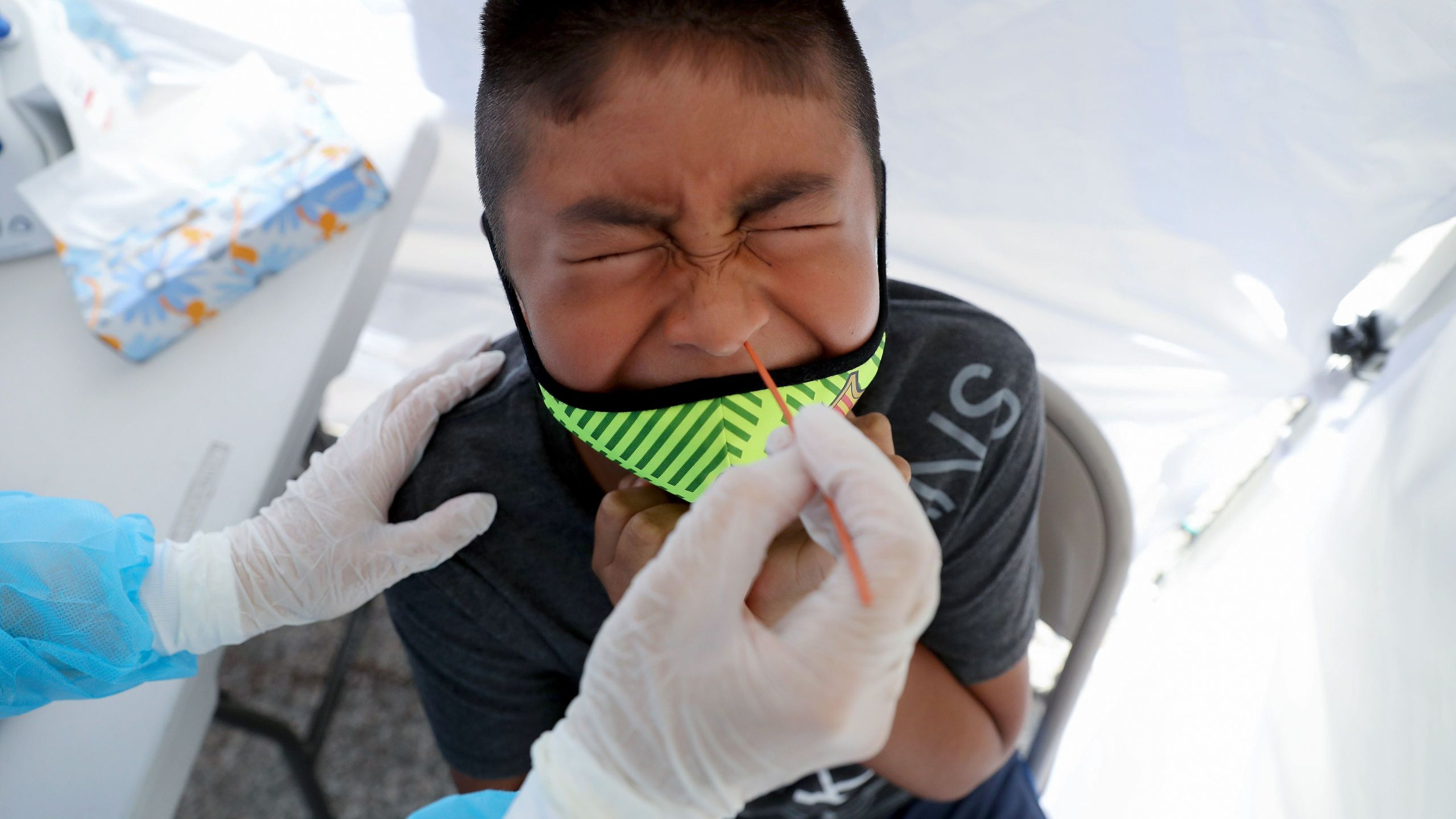 A boy receives a free coronavirus test at a St. John's Well Child & Family Center mobile clinic set up outside Walker Temple AME Church in South Los Angeles on July 15, 2020. (Mario Tama/Getty Images)