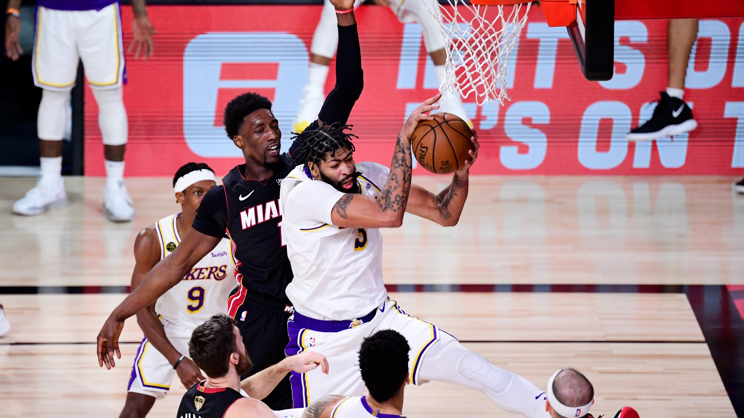 Anthony Davis #3 of the Los Angeles Lakers rebounds the ball against Bam Adebayo #13 of the Miami Heat during the fourth quarter in Game Six of the 2020 NBA Finals at AdventHealth Arena at the ESPN Wide World Of Sports Complex on Oct. 11, 2020 in Lake Buena Vista, Florida. (Douglas P. DeFelice/Getty Images)