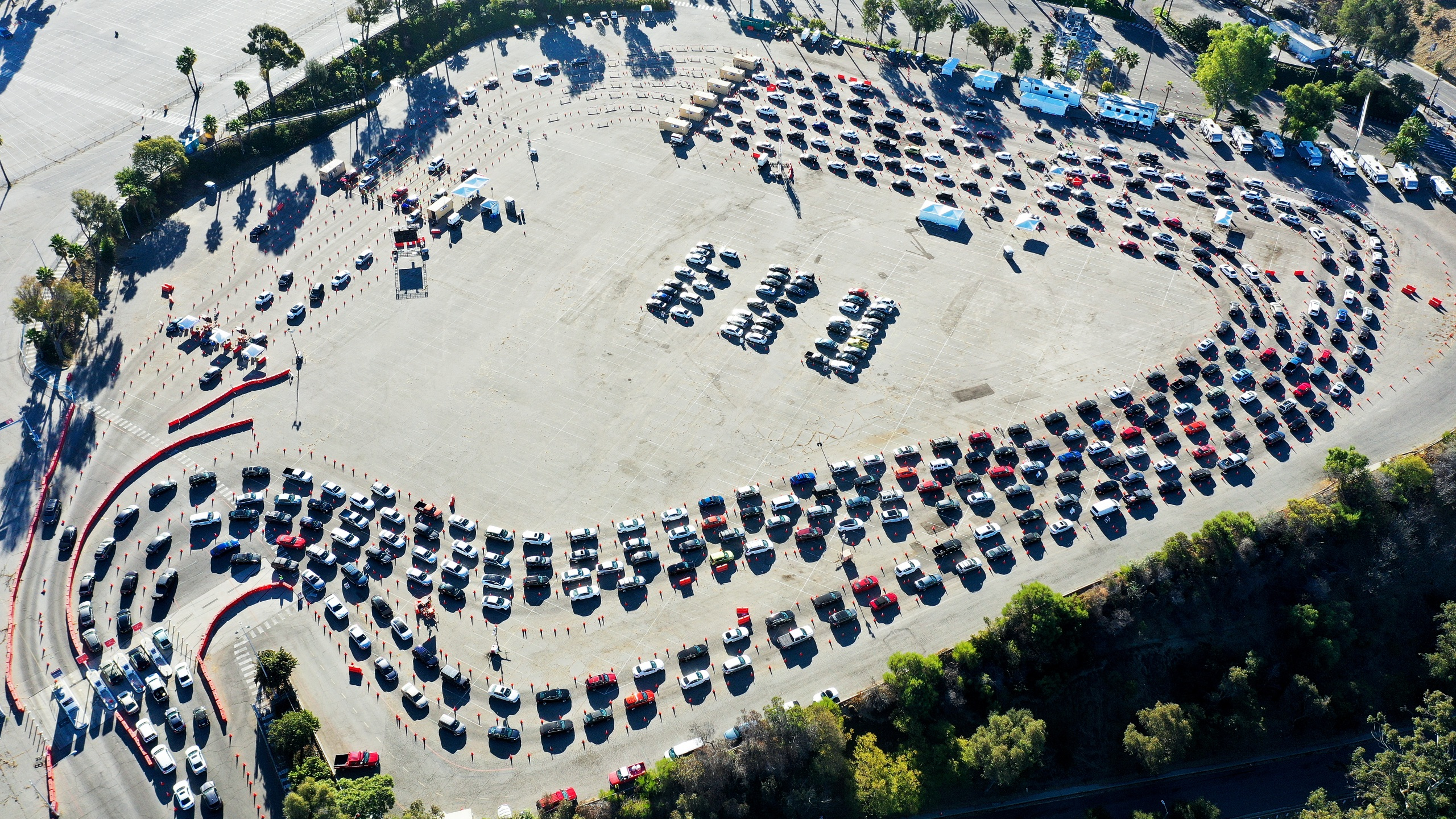 In an aerial view from a drone, cars are lined up at Dodger Stadium for COVID-19 testing on the Monday after Thanksgiving weekend on November 30, 2020 in Los Angeles. (Mario Tama/Getty Images)