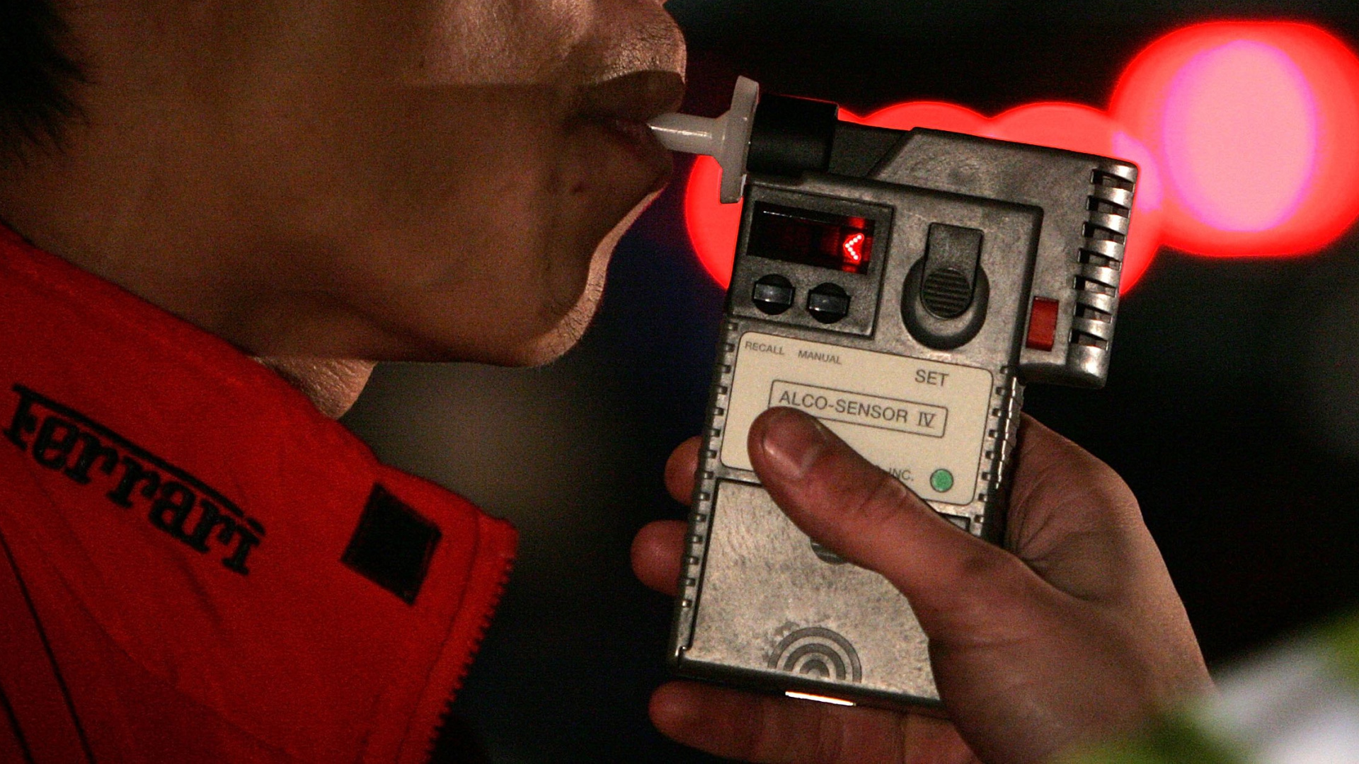 A man blows into a breathalizer during a field sobriety test after he was stopped by San Bruno Police officers at a DUI checkpoint Nov. 27, 2006 in San Bruno. (Justin Sullivan/Getty Images)
