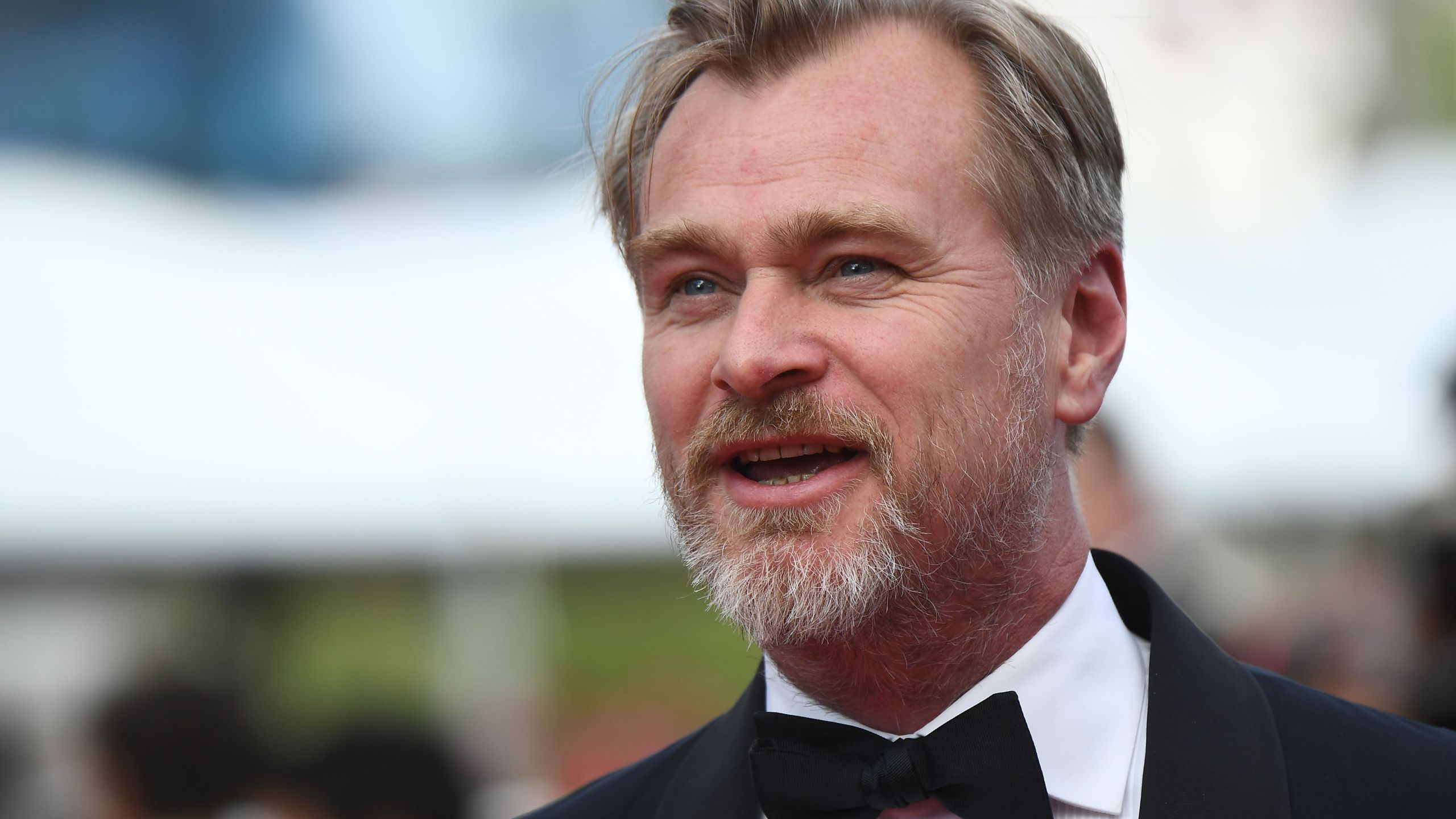 """British director Christopher Nolan poses as he arrives on May 13, 2018, for the screening of a remastered version of the film """"2001: A Space Odyssey"""" at the 71st edition of the Cannes Film Festival in southern France. (ANNE-CHRISTINE POUJOULAT/AFP via Getty Images)"""