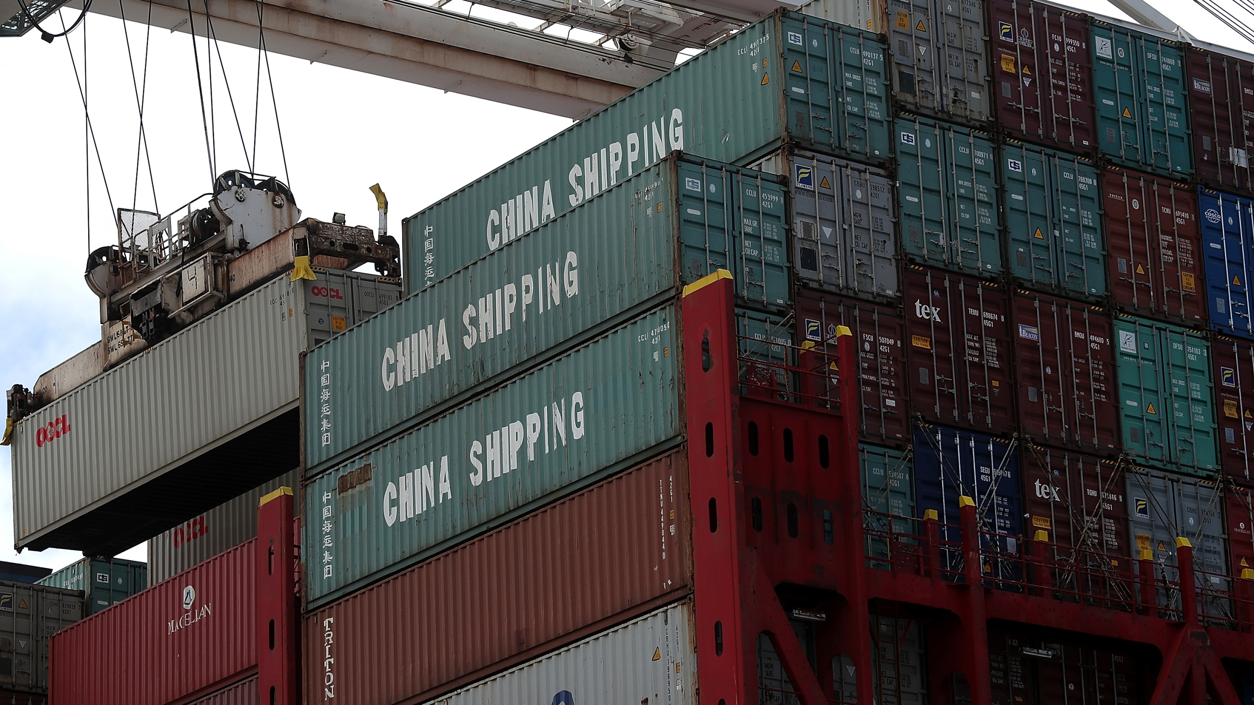 A shipping container is offloaded from the Hong Kong based CSCL East China Sea container ship at the Port of Oakland on June 20, 2018 in Oakland, California. (Justin Sullivan/Getty Images)