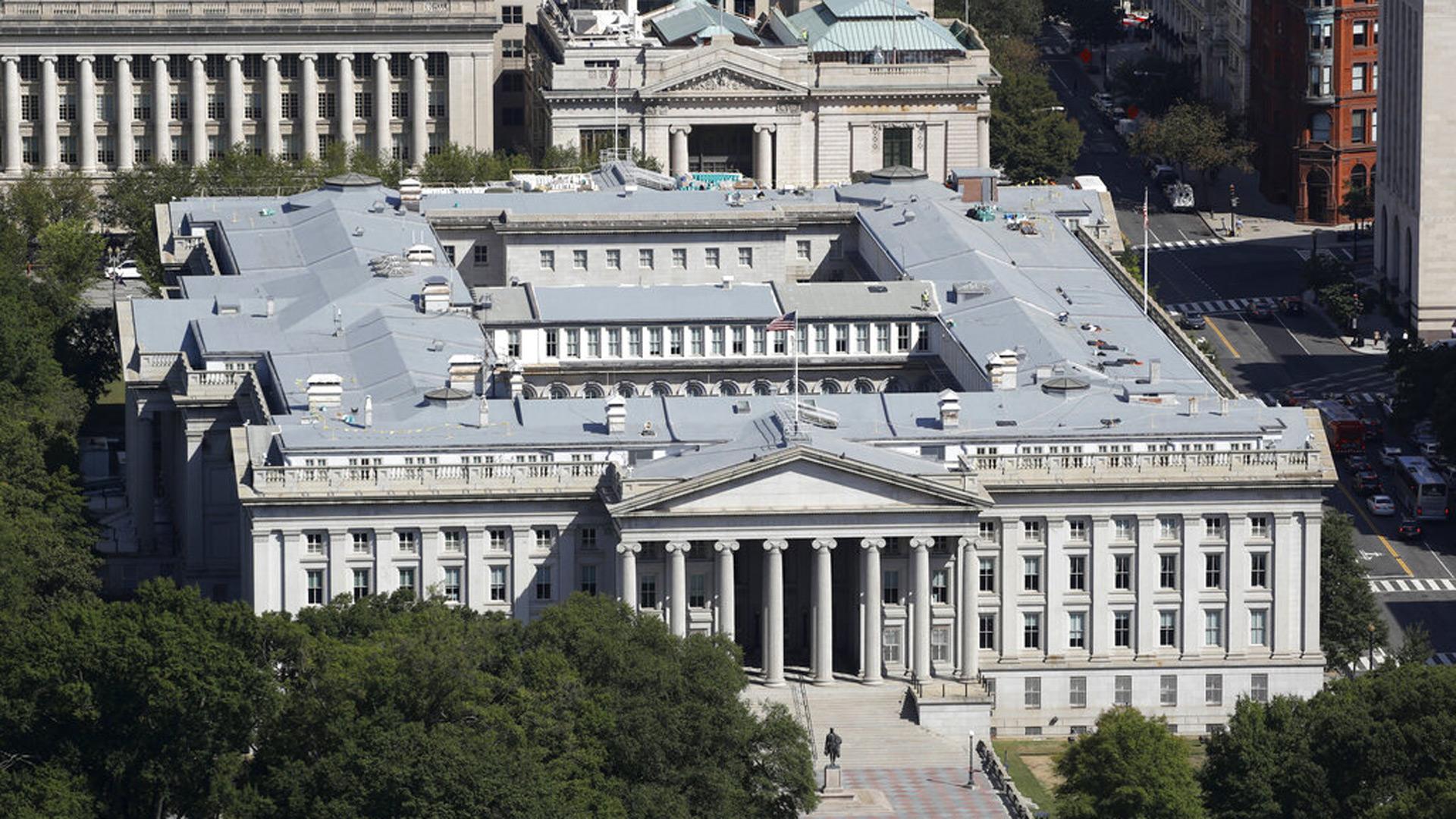 The U.S. Treasury Department building viewed from the Washington Monument, Wednesday, Sept. 18, 2019, in Washington. (AP Photo/Patrick Semansky, file)