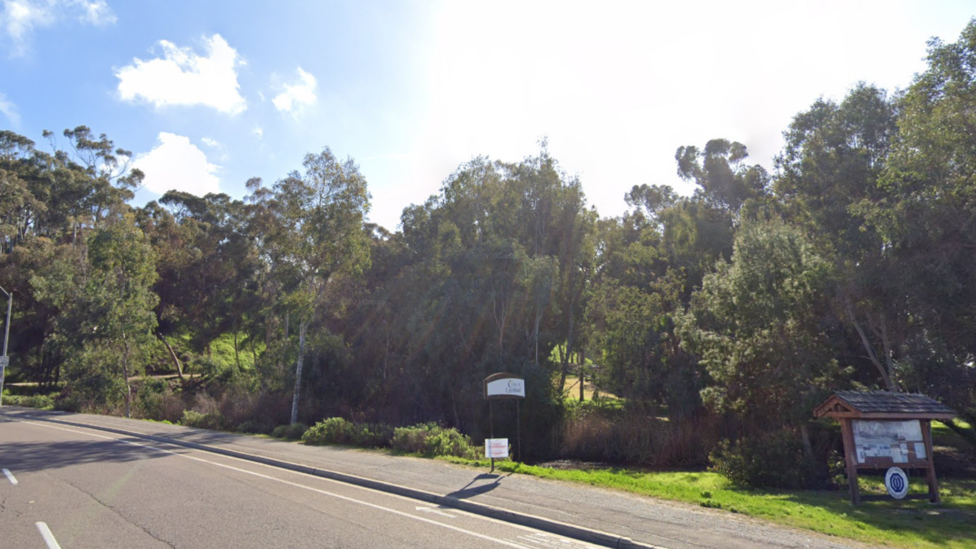 A Google Maps image shows the Hosp Grove Trail in Carlsbad.