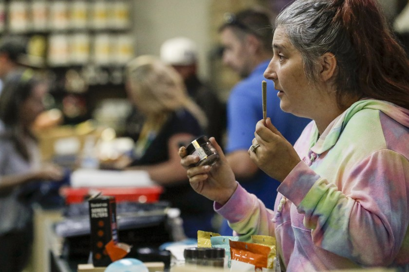 The state Cannabis Advisory Committee on Wednesday recommended loosening rules on marijuana businesses, including delivery firms. Above, Ñ Cheryl Luell at the Healing Center, a marijuana dispensary in Needles, Calif. (Irfan Khan / Los Angeles Times)