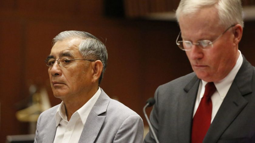 Businessman Samuel Leung, left, stands alongside his lawyer, Daniel V. Nixon, in court in 2018. On Dec. 3, 2020, Leung pleaded guilty to a felony count of conspiracy. (Al Seib / Los Angeles Times)