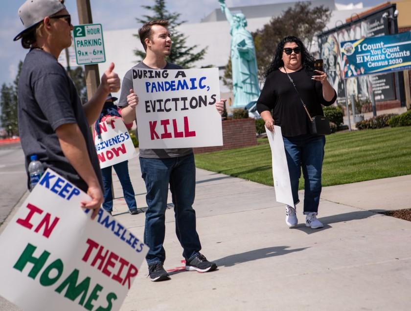 Ian Jameson of El Monte, center, organized a group of tenant rights activists, who assembled at El Monte City Hall in March to demand an eviction moratorium. (Jason Armond / Los Angeles Times)