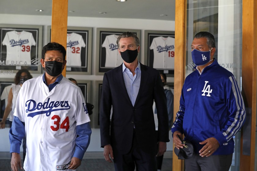 Gov. Gavin Newsom, center, visits Dodger Stadium with former Dodger pitcher Fernando Valenzuela, left, and California Secretary of State Alex Padilla shortly before the November election. Padilla is considered one of the favorites to be appointed to the U.S. Senate to fill a vacancy created when Sen. Kamala Harris is sworn in as vice president.(Carolyn Cole / Los Angeles Times)