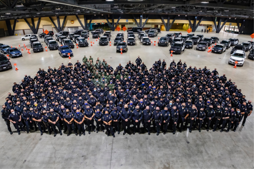 In the official photo released by the Long Beach Police Department, officers are masked. The Long Beach Post published a story with a photo of hundreds of officers gathered without wearing masks. (Long Beach Police Department)