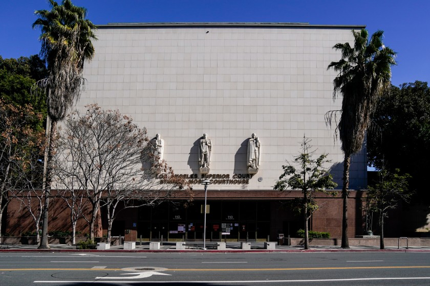 """The Stanley Mosk Courthouse in downtown Los Angeles on March 21, two days after Gov. Gavin Newsom issued a statewide """"stay at home"""" order to slow the spread of the coronavirus. (Kent Nishimura / Los Angeles Times)"""