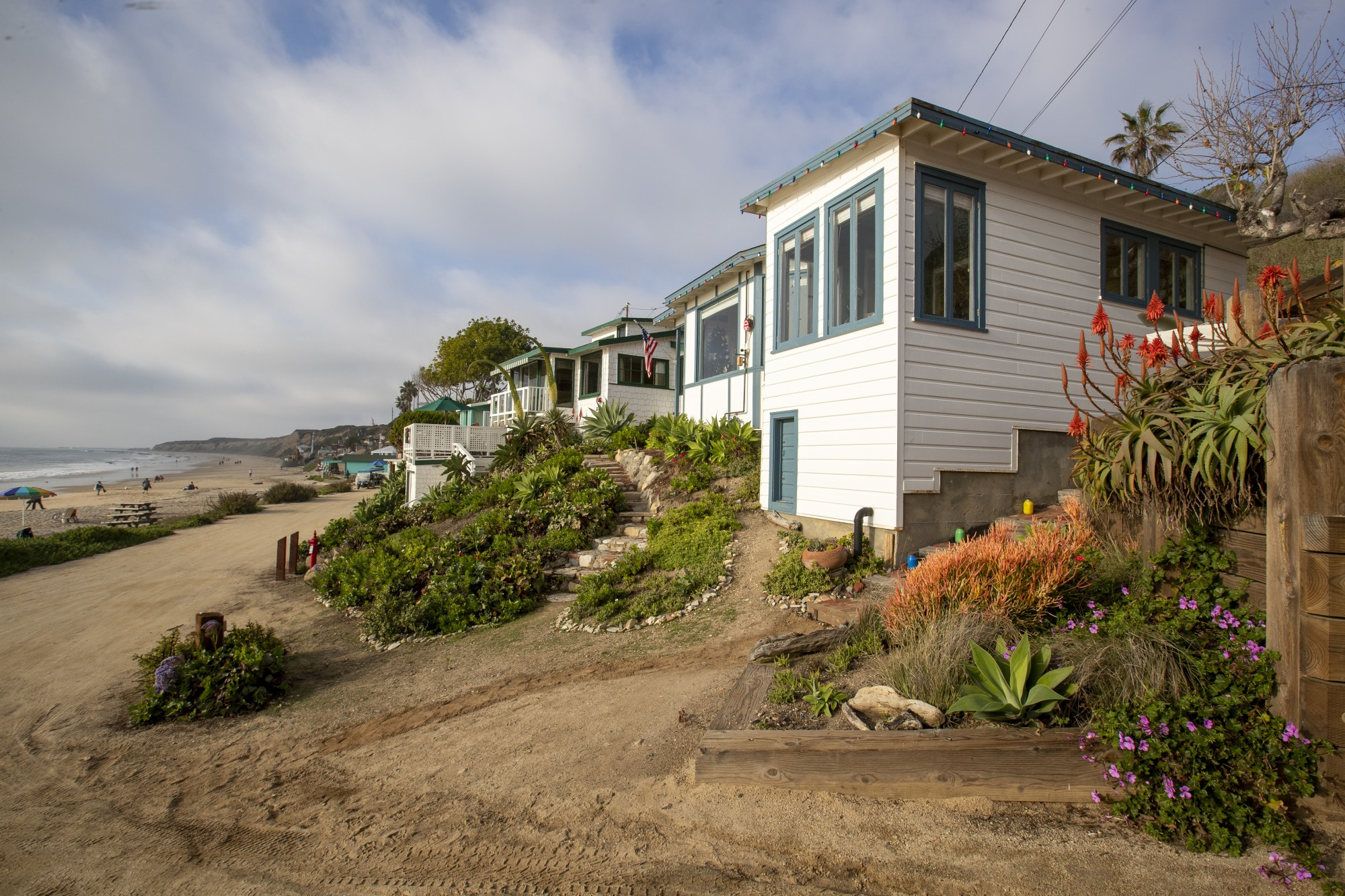 Cottage 21, foreground, and Cottage 17, two doors down, at Crystal Cove State Park are seen in this undated photo. .The cottages are rented to California parks department employees at below-market rates under a program created to allow essential workers to live close to the natural treasures they protect or maintain. (Allen J. Schaben / Los Angeles Times)