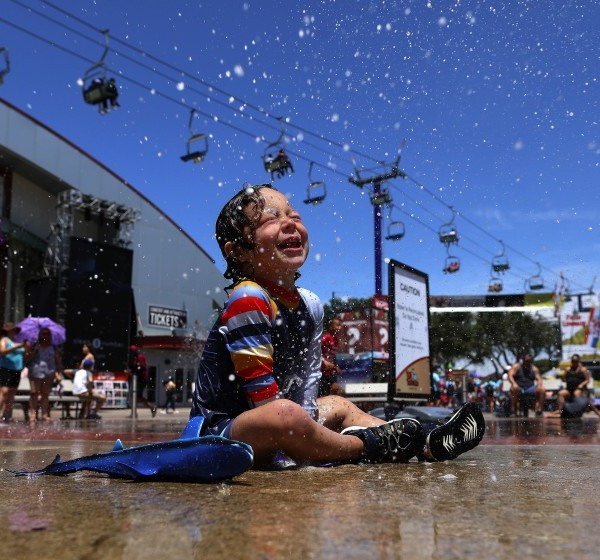 Mason Rose plays in a splash zone at the Orange County Fair in Costa Mesa in 2019. (Gary Coronado/ Los Angeles Times)