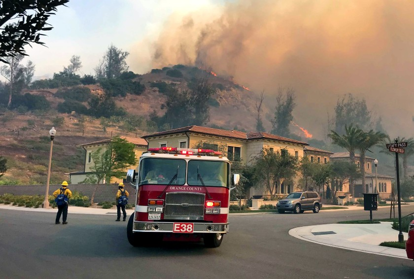 Firefighters stand ready to protect structures in Irvine's Orchard Hills neighborhood from the Silverado fire.(Allen J. Schaben / Los Angeles Times)