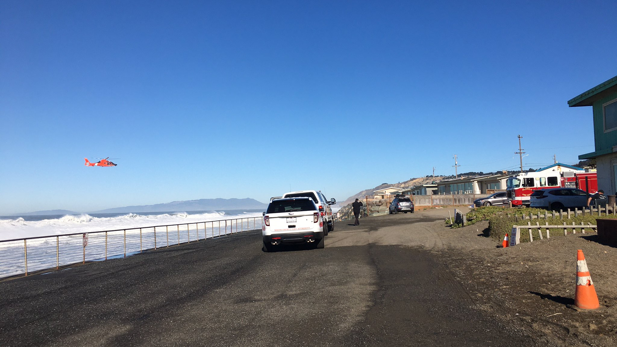 Authorities respond to assist the U.S. Coast Guard with a water rescue in Pacifica on Dec. 8, 2020, in a photo tweeted by the North County Fire Authority.