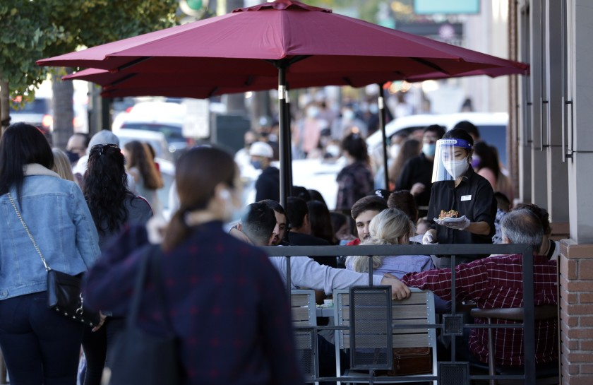 Outdoor dining along Colorado Boulevard in Pasadena is shown in late November 2020. (Myung J. Chun/ Los Angeles Times)