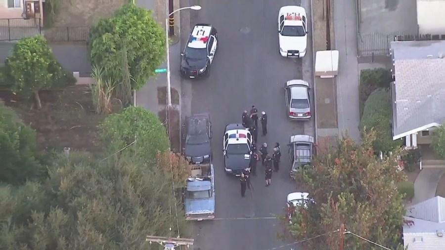 Police investigate a fatal shooting in Pasadena on Dec. 1, 2020. (KTLA)