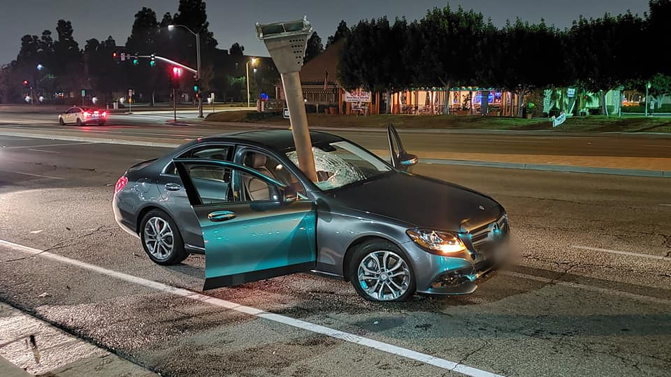 Tustin police released this photo on Dec. 12, 2020 of a car with a metal pole smashed into the windshield.