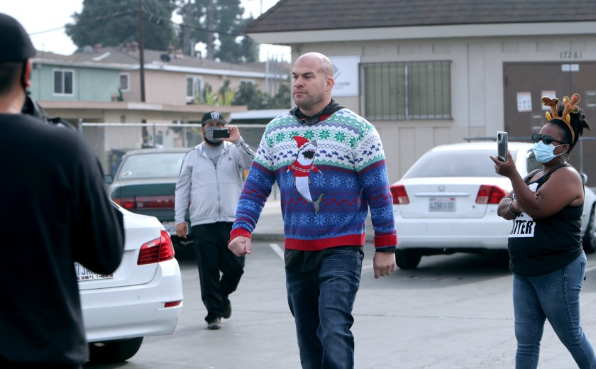 Huntington Beach Mayor Pro Tem Tito Ortiz is approached from all sides with cellphones and a megaphone for not wearing a mask during a food giveaway in the Oak View neighborhood of Huntington Beach on Dec. 23, 2020. (Raul Roa / Times Community News)