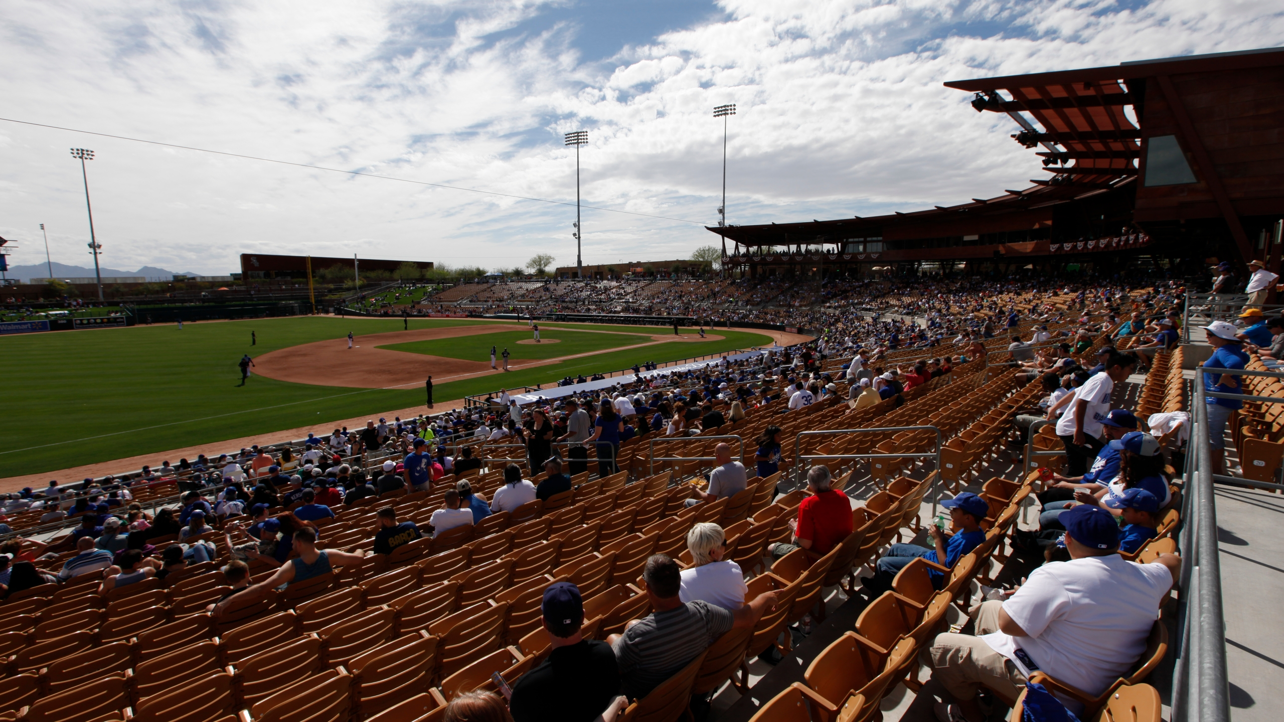Fans watch an exhibition baseball game at Camelback Ranch between the Los Angeles Dodgers and Chicago White Sox in Glendale, Ariz. on Feb. 28, 2014. (Paul Sancya/Associated Press)