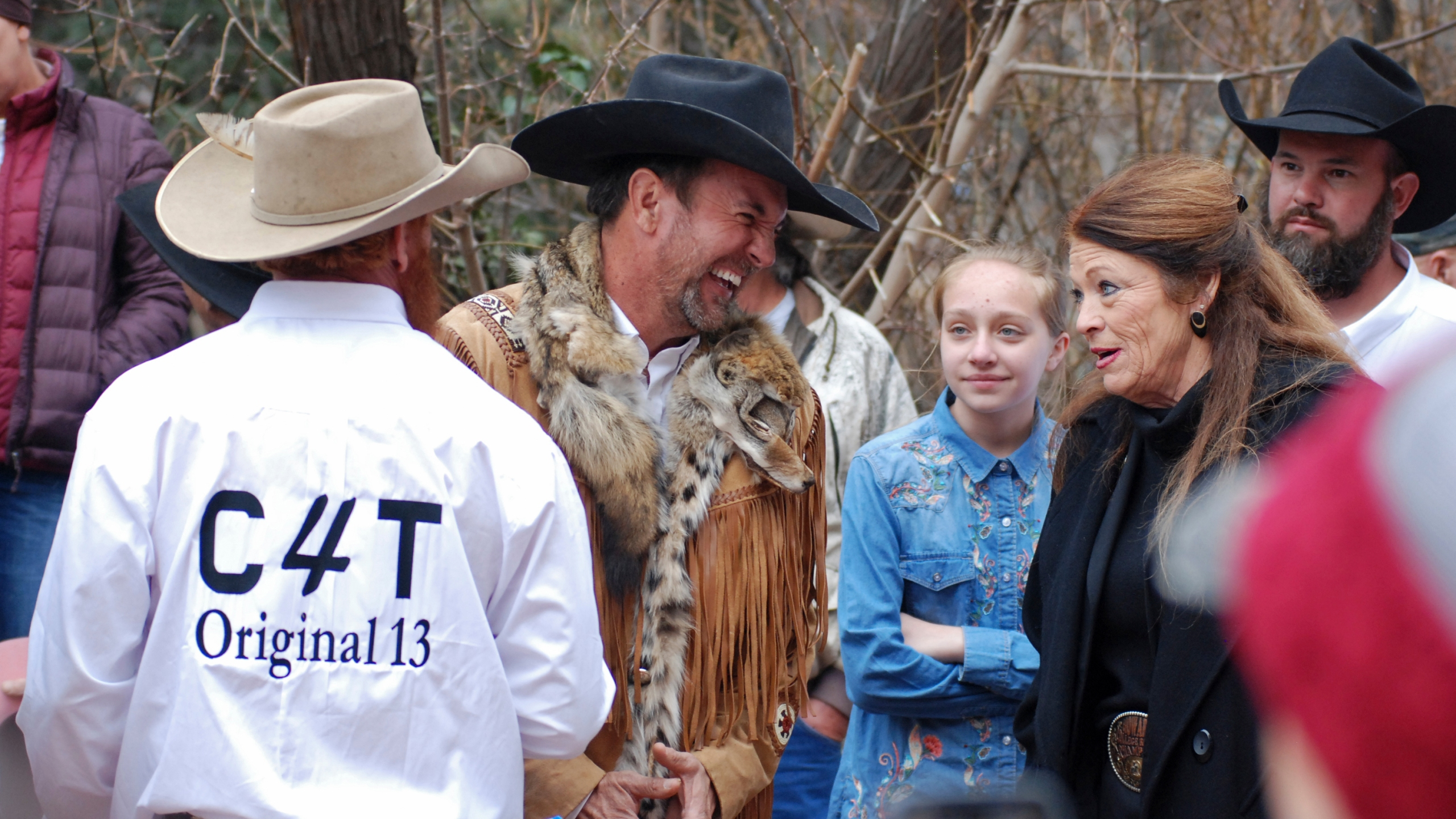 In this March 12, 2019, file photo, Cowboys for Trump leader and Otero County Commissioner Couy Griffin, center, talks with Republican New Mexico state Rep. Candy Ezzell of Roswell, N.M., at a protest against gun control and pro-abortion rights legislation outside the New Mexico state Capitol, in Santa Fe, N.M. (AP Photo/Morgan Lee)