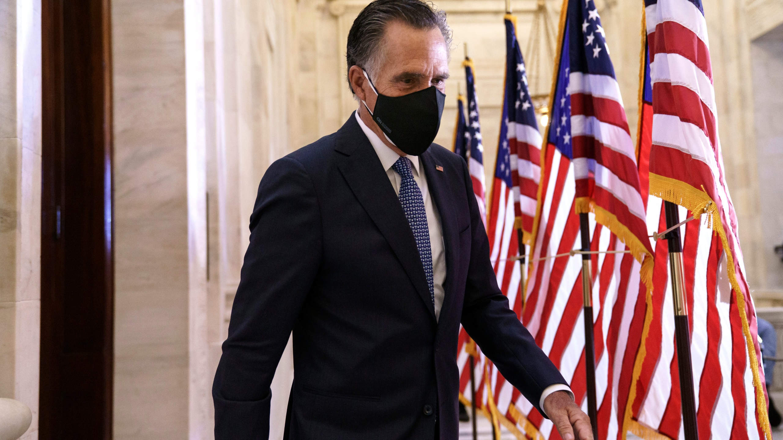 Sen. Mitt Romney, R-Utah, departs after the Republican Conference held leadership elections, on Capitol Hill in Washington, Tuesday, Nov. 10, 2020. (J. Scott Applewhite/AP Photo)