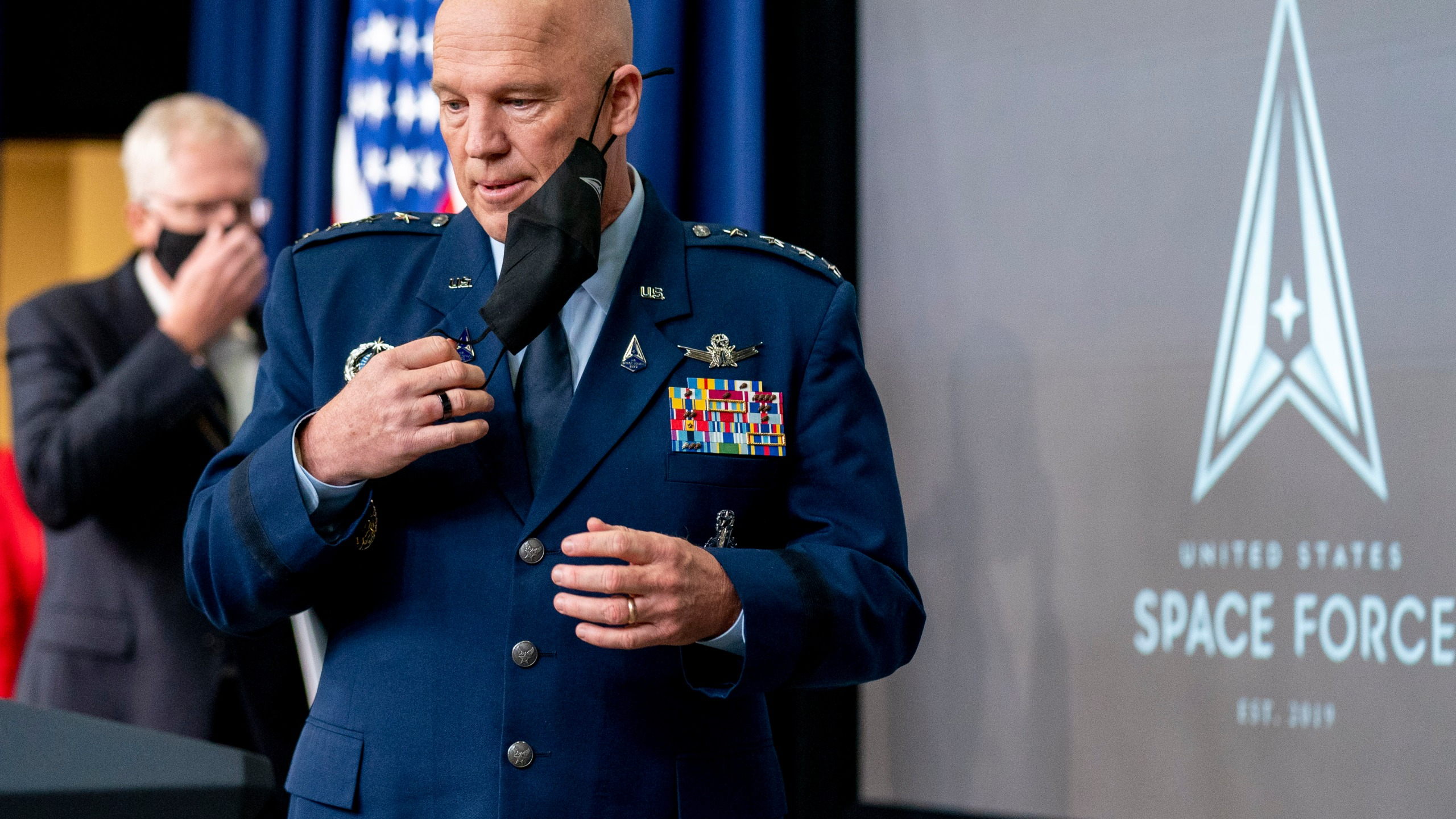 Chief of Space Operations at U.S. Space Force Gen. John Raymond takes the podium to speak at a ceremony to commemorate the first birthday of the U.S. Space Force at the Eisenhower Executive Office Building on the White House complex, Friday, Dec. 18, 2020, in Washington. (AP Photo/Andrew Harnik)