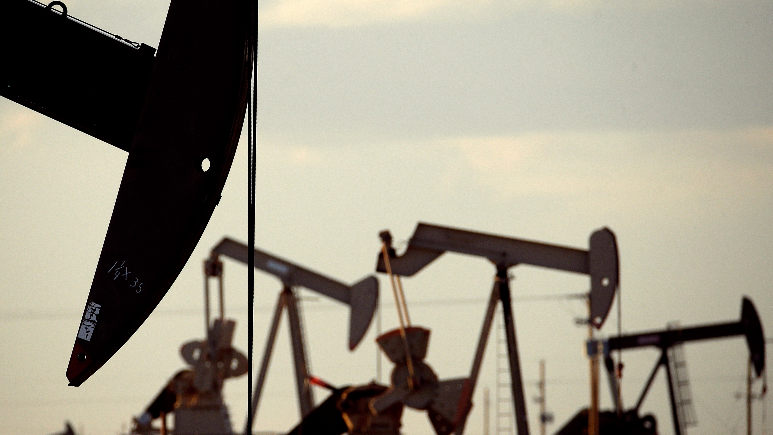 Pumpjacks work in a field near Lovington, N.M., on April 24, 2015. (Charlie Riedel / Associated Press)