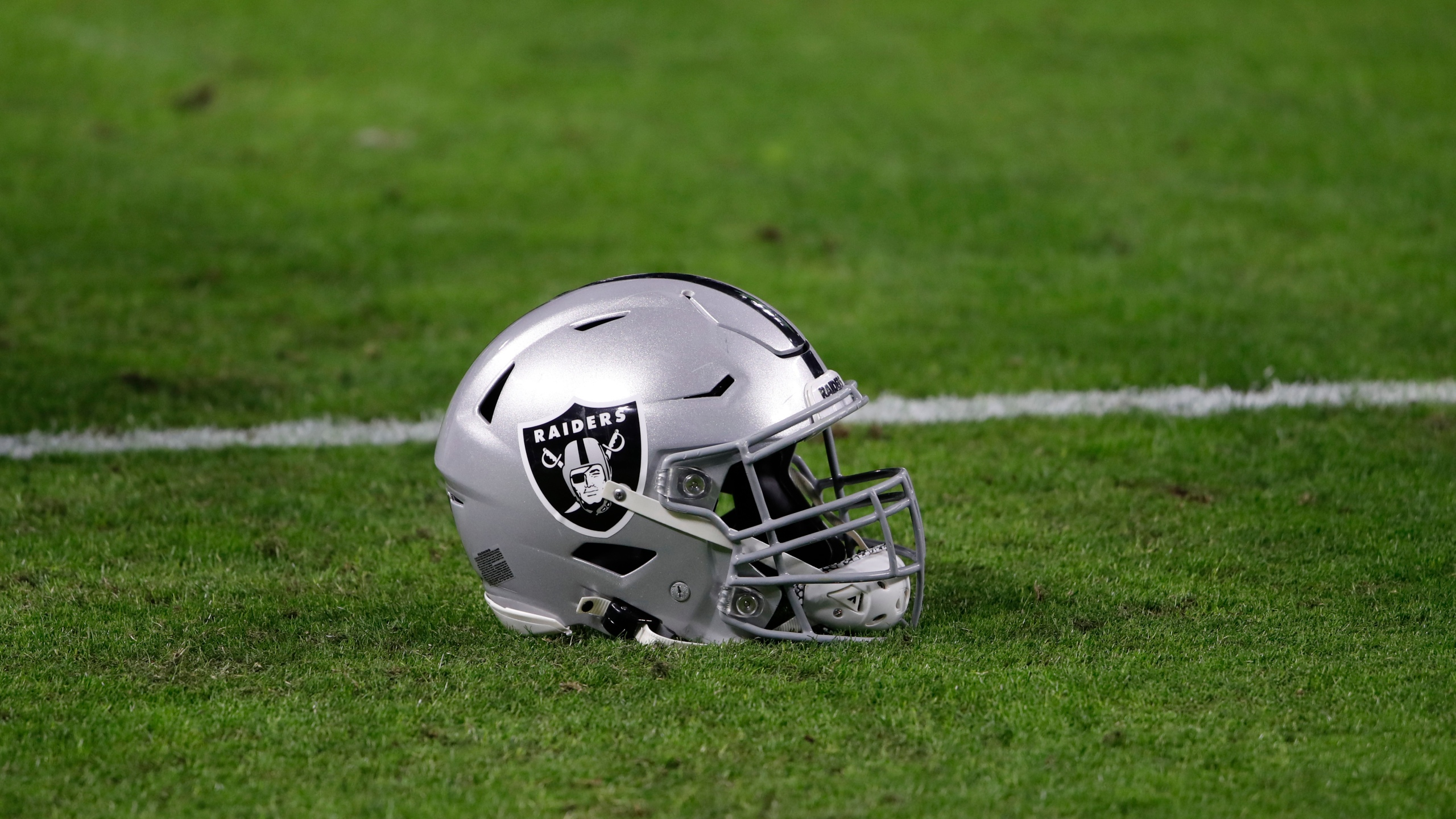 A Las Vegas Raiders helmet is seen before an NFL football game against the Miami Dolphins on Dec. 26, 2020, in Las Vegas. (AP Photo/Steve Marcus)
