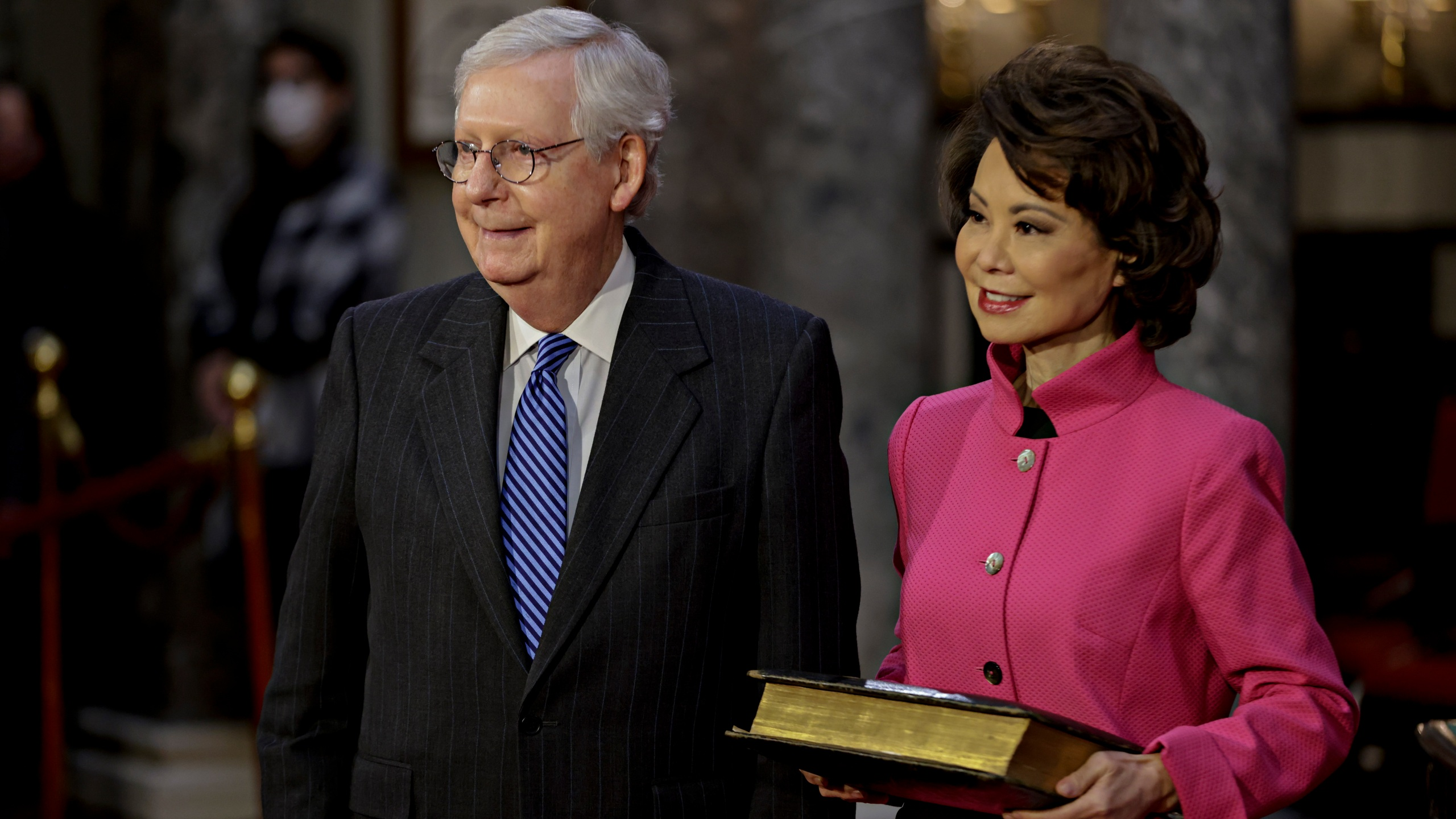 Sen. Mitch McConnell, R-Ky., and his wife Transportation Secretary Elaine Chao, wait for McConnell to be sworn in during a reenactment ceremony in the Old Senate Chamber at the Capitol in Washington, Jan. 3, 2021. (Samuel Corum/Pool via AP)