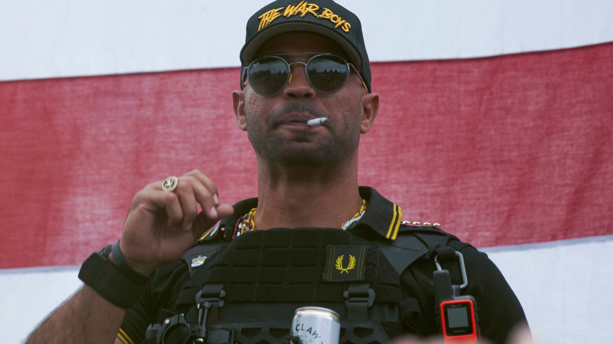 "Proud Boys leader Henry ""Enrique"" Tarrio wears a hat that says The War Boys during a rally in Portland, Ore., on Sept. 26, 2020. (Allison Dinner / Associated Press)"