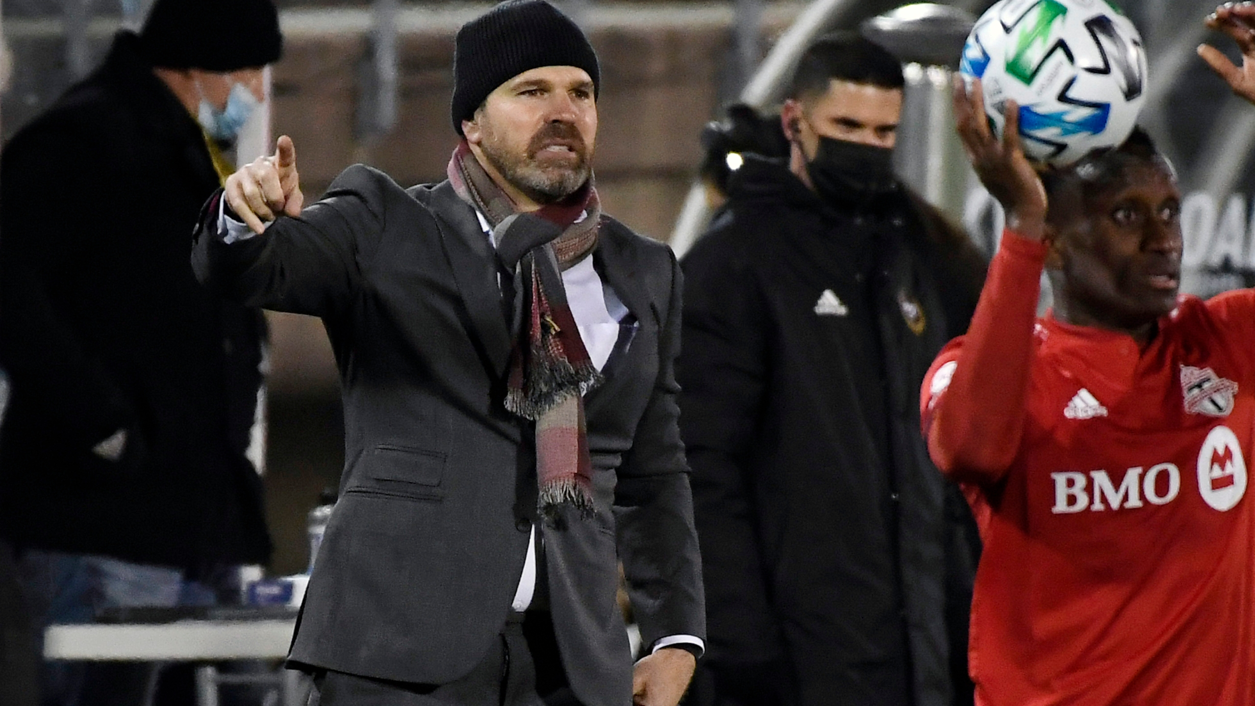 In this Nov. 24, 2020, file photo, then-Toronto FC head coach Greg Vanney, left, calls out to his team during the first half of an MLS soccer playoff match against Nashville SC in East Hartford, Conn. (Jessica Hill/Associated Press)