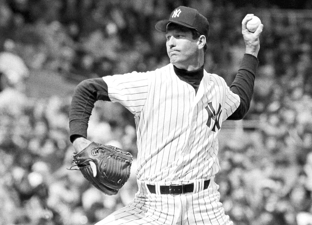 In this 1979 file photo, New York Yankees pitcher Tommy John delivers during a baseball game. (AP Photo/File)