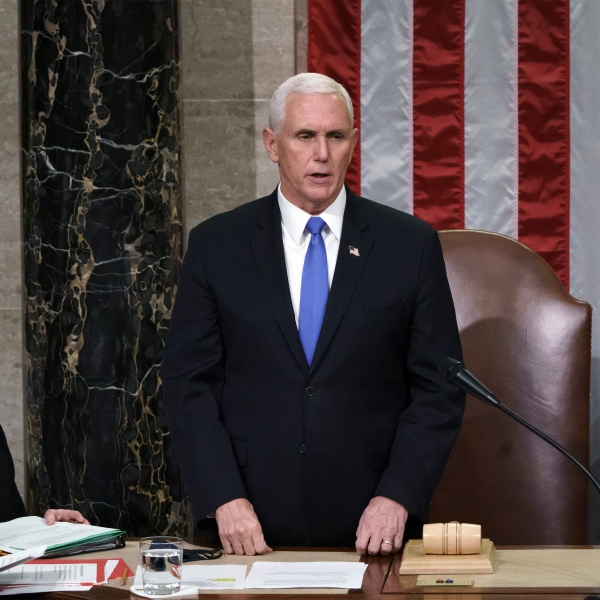 Vice President Mike Pence listens after reading the final certification of Electoral College votes cast in November's presidential election during a joint session of Congress after working through the night, at the Capitol in Washington, on Jan. 7, 2021. (J. Scott Applewhite / Associated Press)