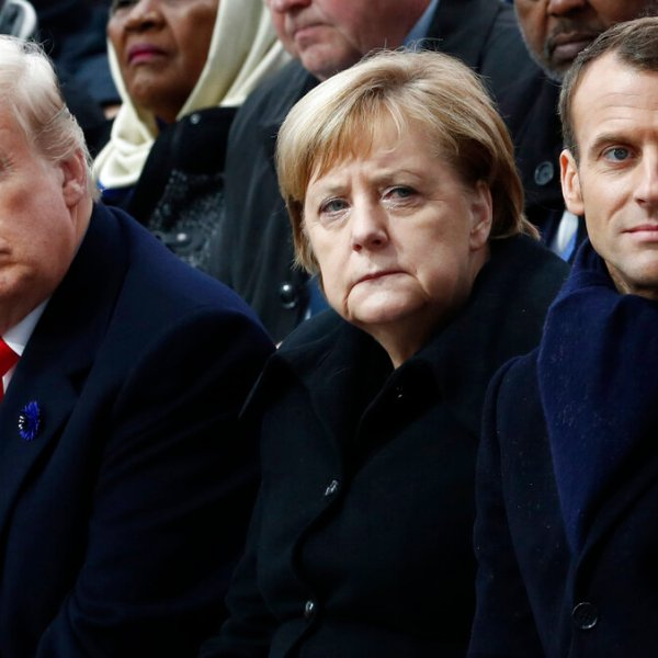 In this Nov.11, 2018 file photo, French President Emmanuel Macron, German Chancellor Angela Merkel and President Donald Trump attend a commemoration ceremony for Armistice Day, 100 years after the end of the First World War at the Arc de Triomphe in Paris, France. (Benoit Tessier/Pool Photo via AP)
