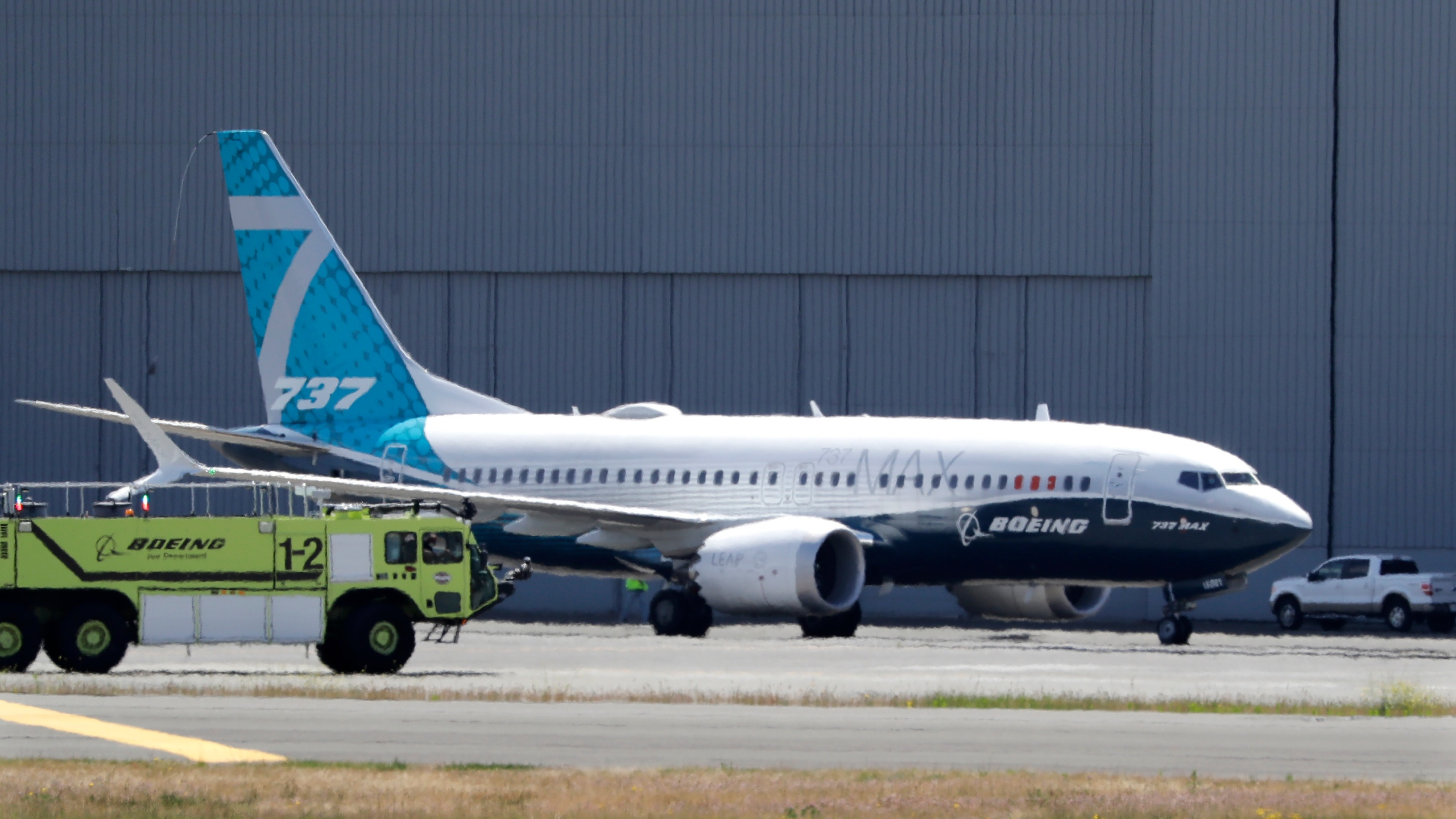 In this June 29, 2020, file photo, A Boeing 737 MAX jet taxis after landing at Boeing Field following a test flight in Seattle. (Elaine Thompson/Associated Press)