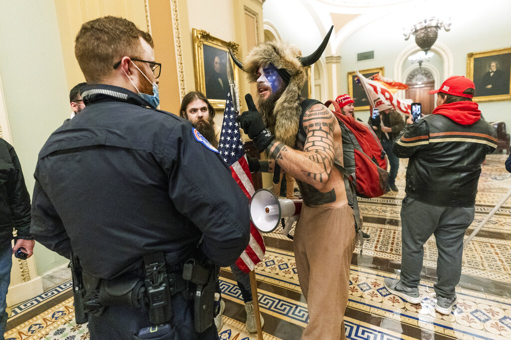 U.S. Capitol Rioter Seen in Horned Helmet and Carrying Spear Arrested and Charged