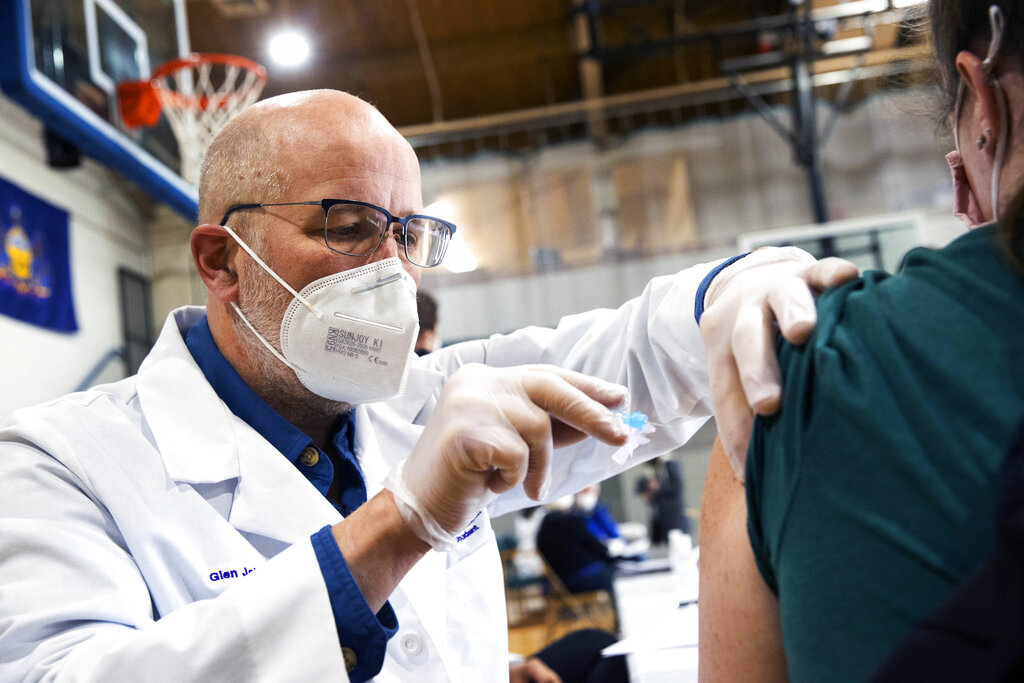 University of Scranton nursing student Glen Johnson administers the Moderna COVID-19 vaccine to a medical professional during a clinic in Throop, Pa. on Jan. 9, 2021. (Christopher Dolan/The Times-Tribune via AP)