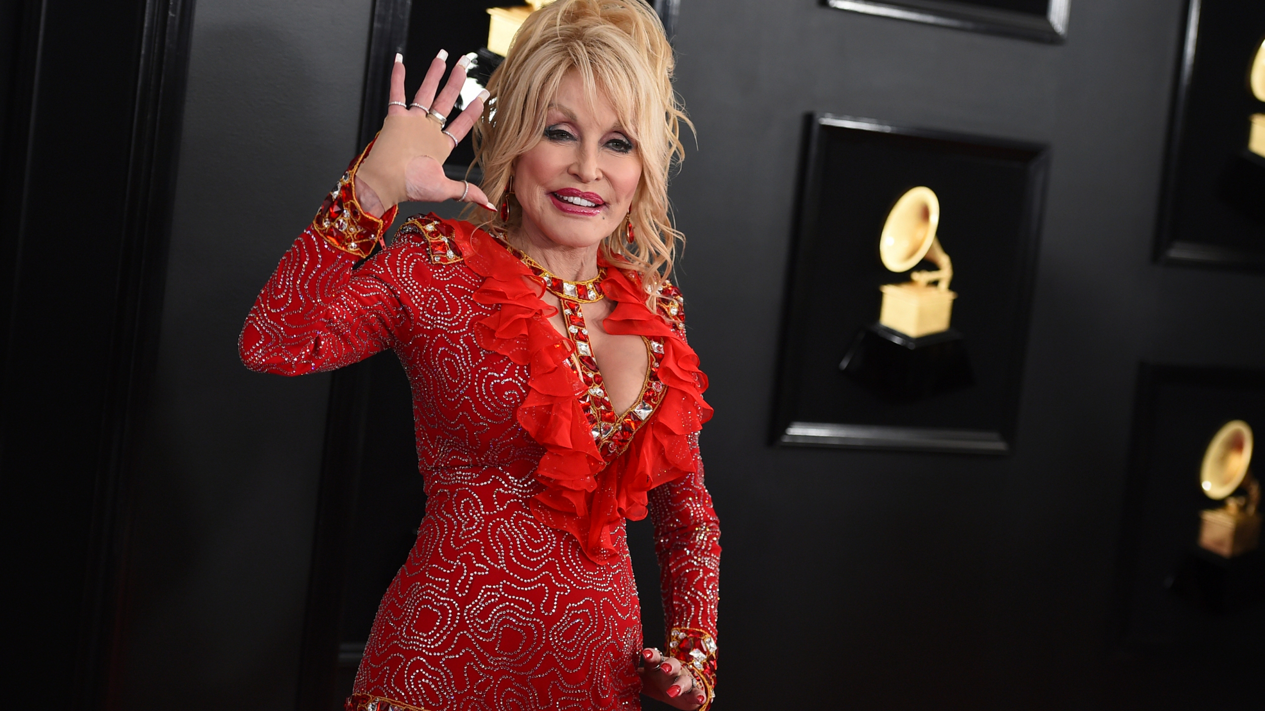 Dolly Parton arrives at the 61st annual Grammy Awards in Los Angeles on Feb. 10, 2019. (Jordan Strauss/Invision/Associated Press)